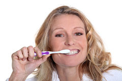 Woman is brushing her teeth Royalty Free Stock Photo