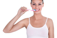 Woman brushing her teeth Stock Images