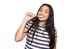Woman brushing her teeth. Royalty Free Stock Images