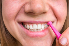 Woman brushing her teeth with interdental brush Stock Photography