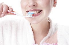 Woman  brushing her teeth. Stock Photos