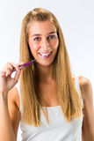 Woman brushing her teeth with toothbrush Stock Photo