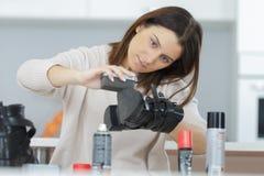 Woman brushing the shoe. Shine royalty free stock photos
