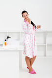 Woman brushing teeth stock image