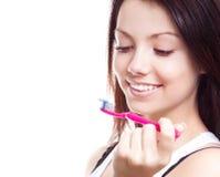 Woman brushing teeth Royalty Free Stock Photography