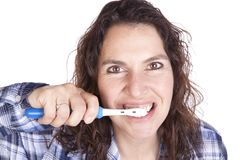 Woman brushing teeth close Stock Photos