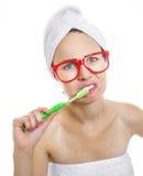 Woman brushing teeth Stock Photos