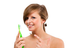 Woman brushing teeth isolated on white Stock Photography
