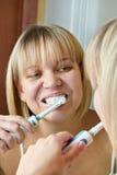 Woman brushing teeth Stock Photography
