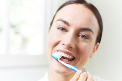 Woman Brushing Teeth With Toothbrush In Bathroom Stock Photography