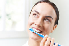 Woman Brushing Teeth With Toothbrush In Bathroom Royalty Free Stock Photography