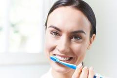 Woman Brushing Teeth With Toothbrush In Bathroom Stock Photo