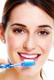 Woman brushing teeth. Royalty Free Stock Photo