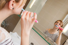 Woman Brushing Teeth Royalty Free Stock Photo