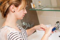 Woman Brushing Teeth Royalty Free Stock Image
