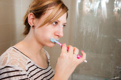 Woman Brushing Teeth Stock Photography