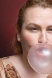Woman bubble gum. Woman blowing a big bubble gum Stock Photo