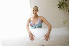 Woman with bubble wrap, portrait Royalty Free Stock Images