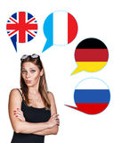 Woman and bubbles with countries flags. Young woman surrounded by dialogue bubbles with countries flags. Germany,  Britain, Russia, Czech. Learning of foreign Royalty Free Stock Image