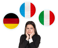 Woman and bubbles with countries flags. Young woman surrounded by dialogue bubbles with countries flags. Germany,  Italian, Czech. Learning of foreign languages Royalty Free Stock Photography