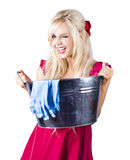 Woman with bucket and rubber gloves Royalty Free Stock Photo