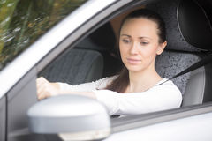 Woman buckling a seat belt Stock Image
