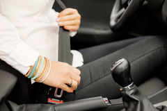 Woman buckling up Royalty Free Stock Photography