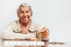 Woman budget with big savings for travel. Senior woman budget with big savings for travel Stock Image