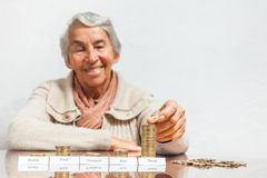 Woman budget with big savings for travel. Senior woman budget with big savings for travel Royalty Free Stock Image