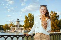 Woman at Buen Retiro Park with traditional Spain churro royalty free stock photos