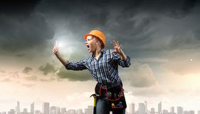 Woman builder in anger Stock Photos