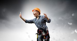Woman builder in anger Royalty Free Stock Images