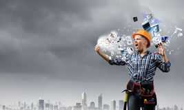 Woman builder in anger Royalty Free Stock Photos