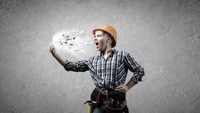 Woman builder in anger Stock Photography