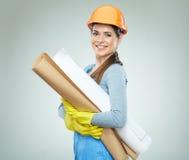 Woman builder architect holding blueprints. Stock Photography