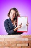 Woman builder and brick wall Royalty Free Stock Photos