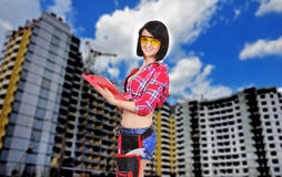 Woman builder with clipboard Royalty Free Stock Images