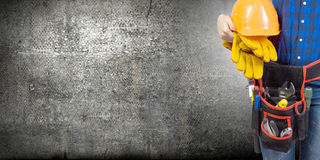 Woman builder. Close up of woman builder with hardhat in hands Stock Images