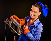 Woman in builder clothers holding circular saw Stock Photos