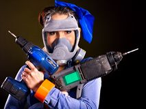 Woman builder with construction tools. Royalty Free Stock Photo