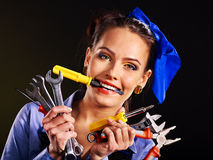 Woman builder with construction tools. Royalty Free Stock Images