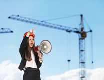 Woman-builder in hardhat screaming Royalty Free Stock Photography