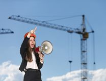 Woman-builder in hardhat screaming stock photo