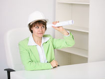 The woman - builder in helmet with a drawing Stock Photography
