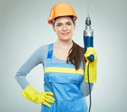 Woman builder holding drill tool. Royalty Free Stock Images