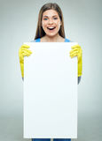 Woman builder holding white banner with copy space. Royalty Free Stock Images