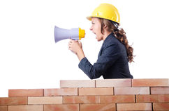Woman builder with loudspeaker Stock Photos