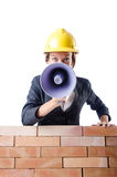 Woman builder with loudspeaker Stock Images