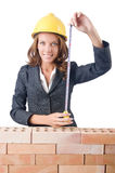 Woman builder measuring Stock Images