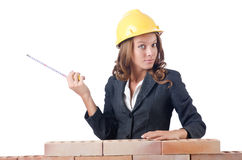 Woman builder measuring Royalty Free Stock Photo